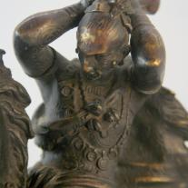 BRONZE STATUE OF A WARRIOR MOUNTING A HORSE